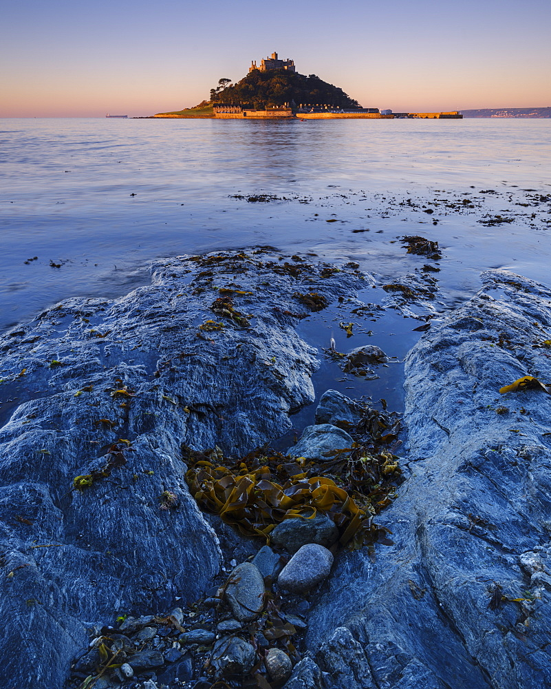 Sunrise with warm light making the granite walls golden at St. Michael's Mount in Marazion, Cornwall, England, United Kingdom, Europe - 1295-85