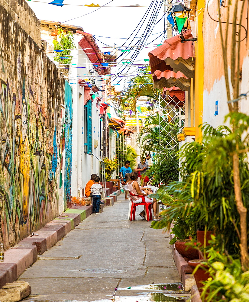 A typically colourful street scene in Getsemani in Cartagena, Colombia, South America.