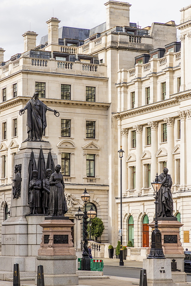 A street view, including the Crimean War Memorial, Waterloo Place, St. James, London, England, United Kingdom, Europe