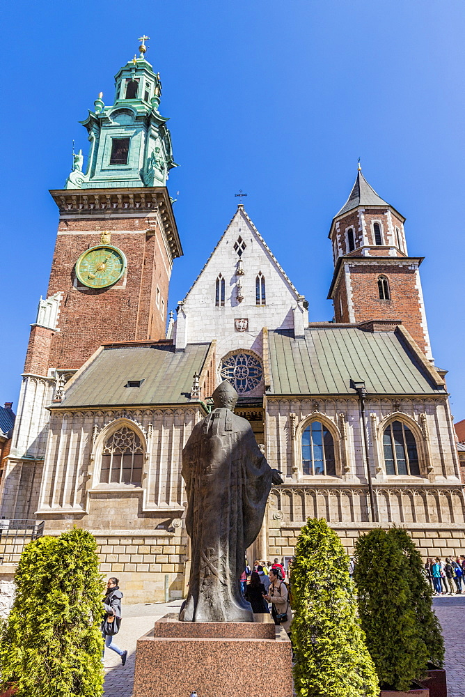 Statue of John Paul II at Wawel Royal Castle, a UNESCO World Heritage Site, in the medieval old town, in Krakow, Poland, Europe.