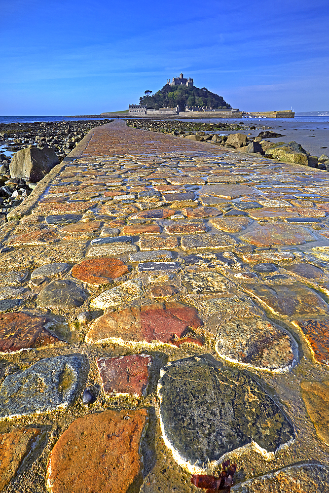 The cobbled causeway leading to St Michael's Mount at Marazion, Cornwall, England, United Kingdom, Europe.