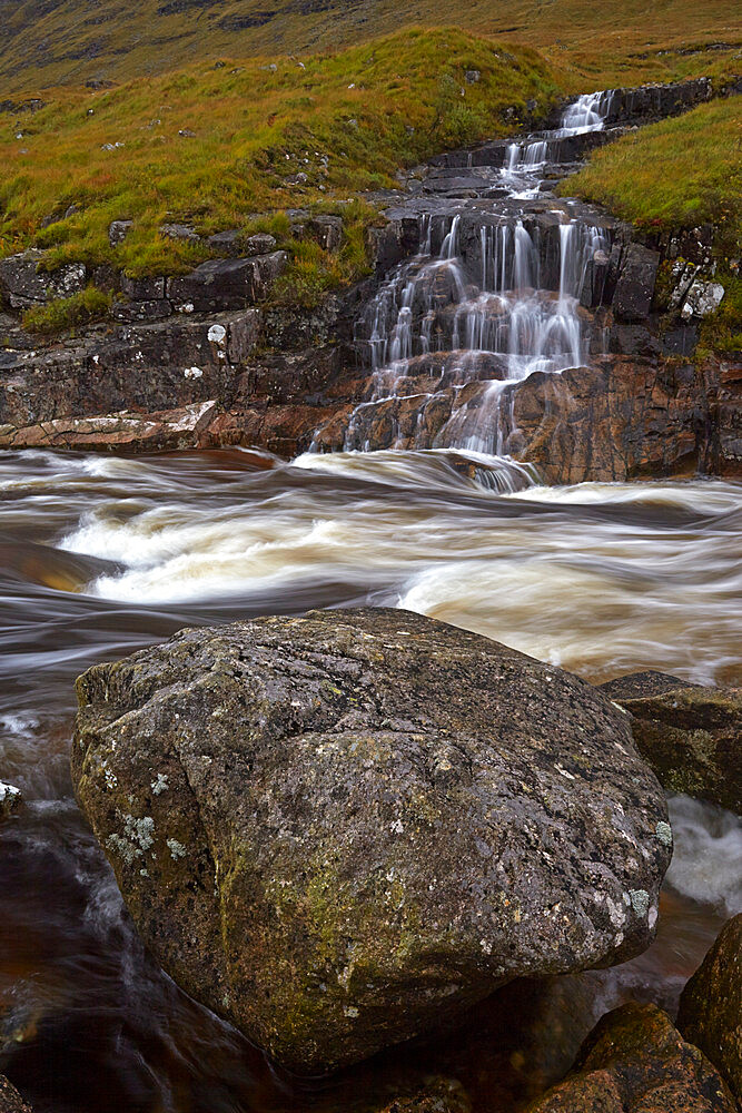 Waterfall cascading in to the River Etive, Glen Etive, Argyll and Bute, Scotland, United Kingdom, Europe