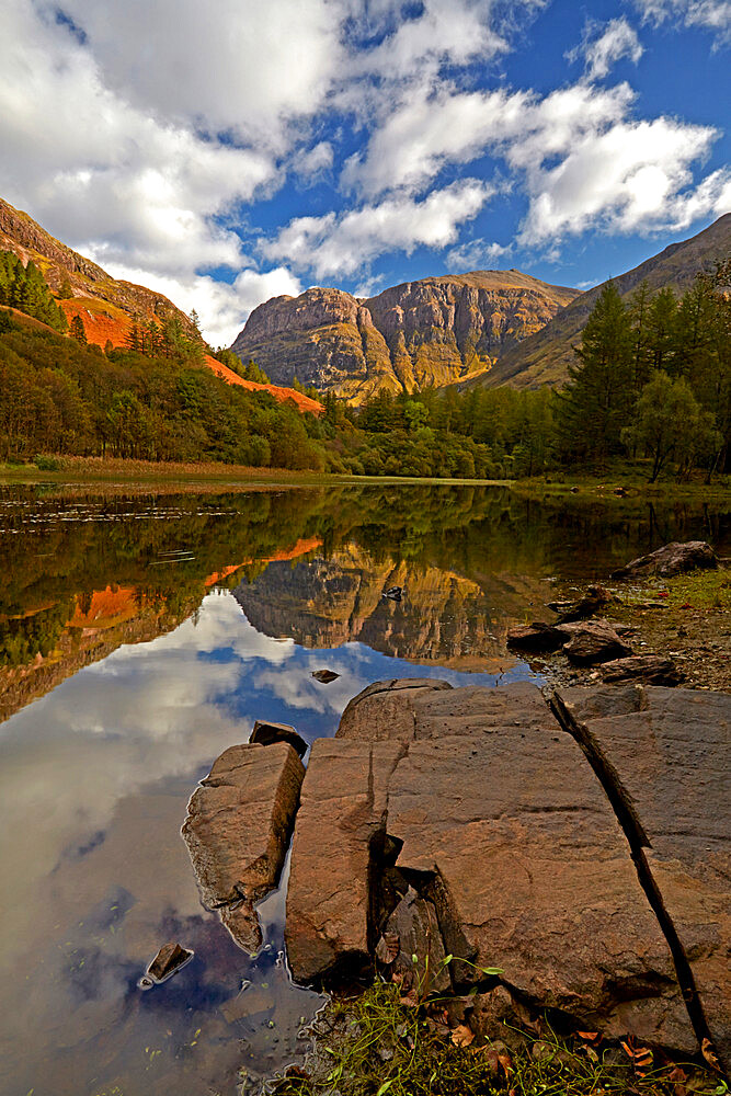 The rugged peak of Aonach Dubh reflected in Torren Lochan, Glencoe, Argyll and Bute, Scotland, United Kingdom, Europe