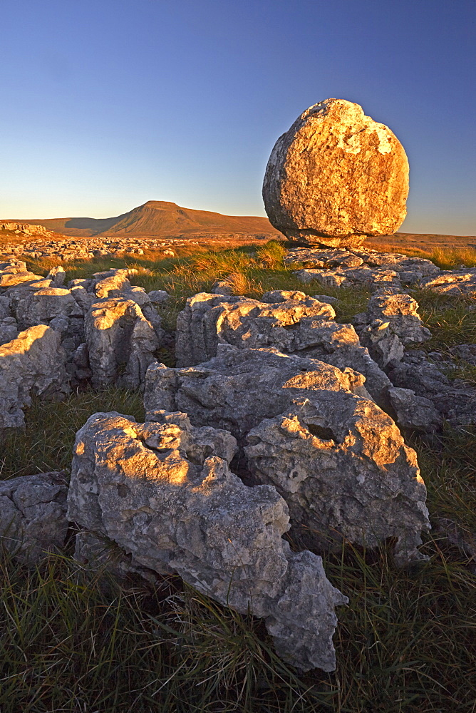 Ingleborough seen from a limestone boulder on Twistleton Scar, Yorkshire Dales National Park, North Yorkshire, England, U.K.