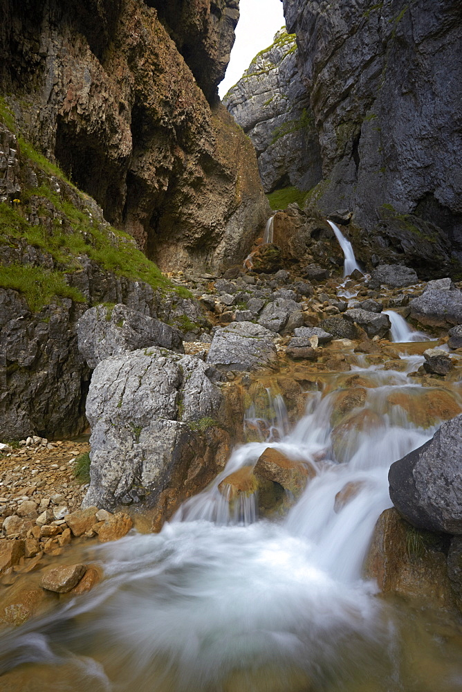 The Gordale beck flowing through the narrow limestone gorge of Gordale Scar, North Yorkshire, England, United Kingdom, Europe
