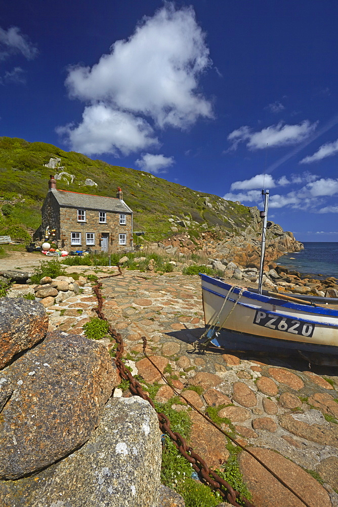 Fisherman's cottage and boat at Penberth Cove, Cornwall, England, U.K.