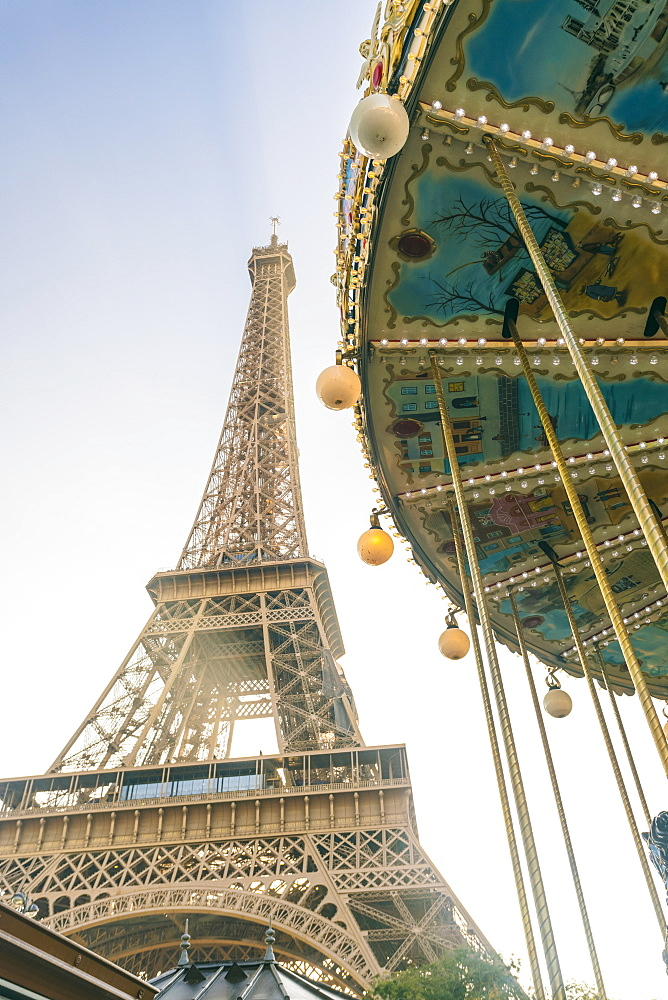 Eiffel tower with a classic carousel in the foreground early in the morning, Paris, France, Europe - 1300-13