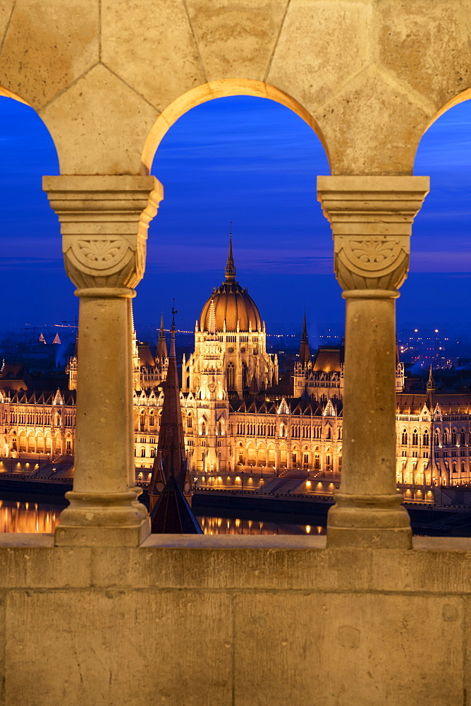 The view of the Hungarian Parliament at night, from the columns of the Fisherman's Bastion, UNESCO World Heritage Site, Budapest, Hungary, Europe