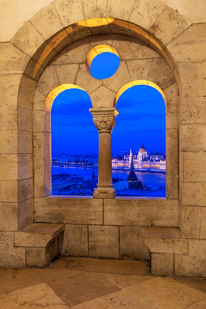 View of the Hungarian Parliament at night, from the stone window at Fisherman's Bastion, UNESCO World Heritage Site, Budapest, Hungary, Europe