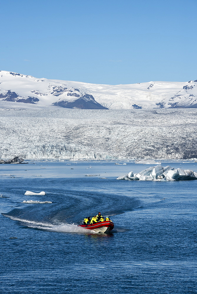 Boat tour on Jokulsarlon Glacier Lagoon, with Breidamerkurjokull Glacier behind, South East Iceland, Iceland, Polar Regions