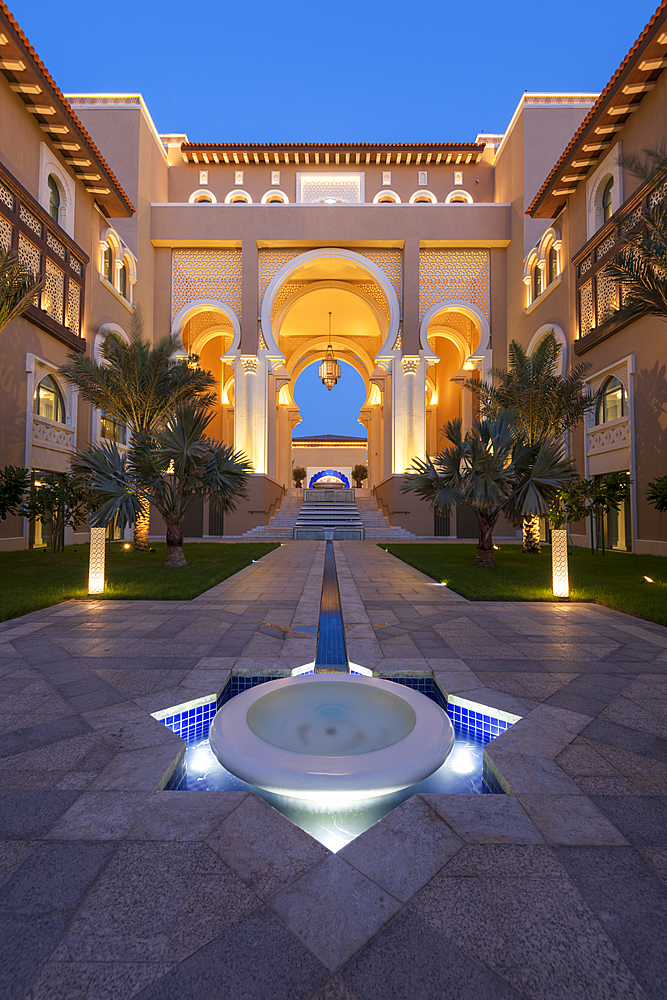 Water feature and architecture at night of luxury hotel, Saadiyat island, Abu Dhabi, United Arab Emirates, Middle East