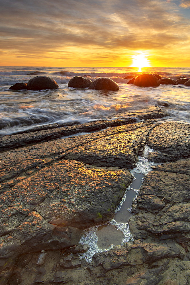 Spectacular sunrise at The Moeraki Boulders, Moeraki Beach, Otago, South Island, New Zealand, Pacific