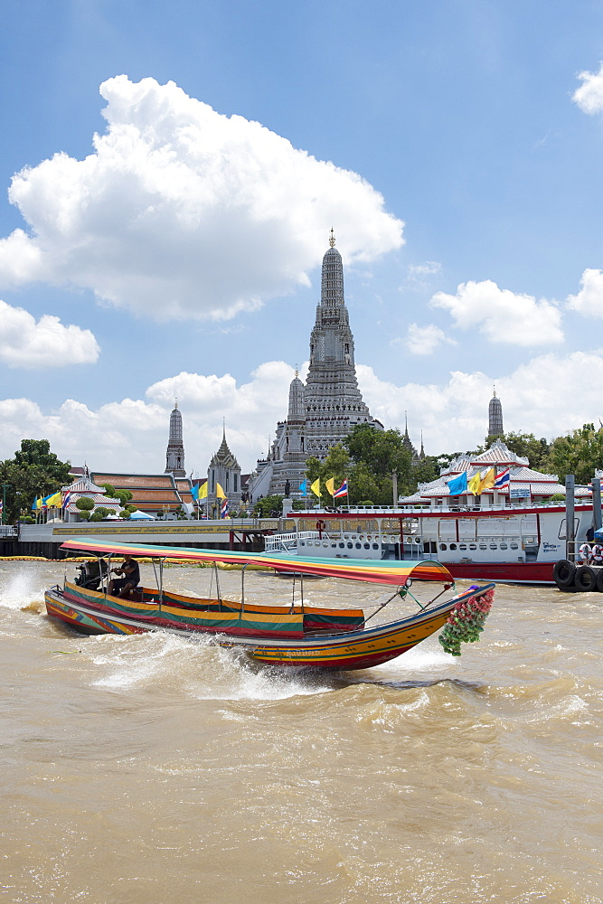 Wat Arun, Temple of Dawn, Ruea Hang Yao or long tail boat on the Chao Phraya River, at sunset, Bangkok, Thailand,