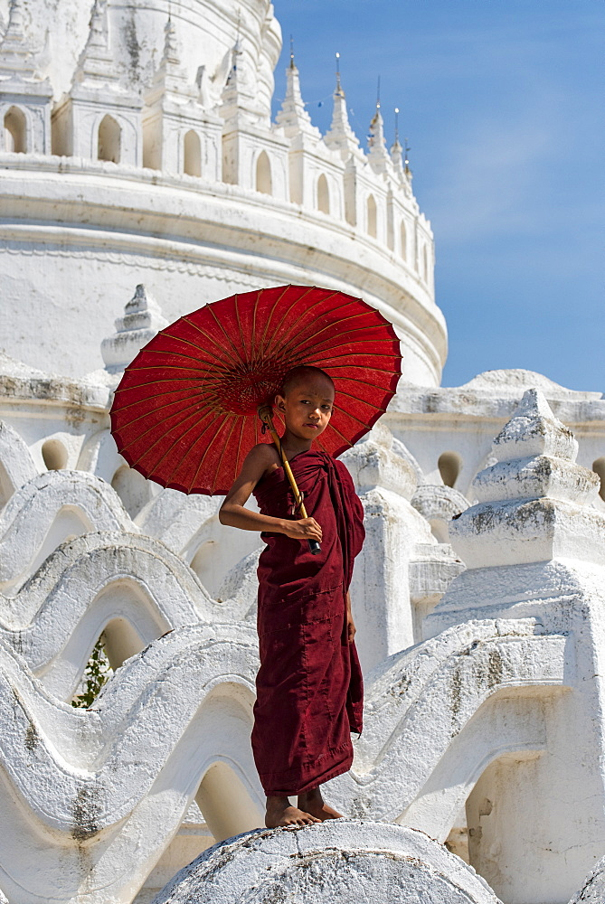 Young novice Buddhist monk standing on temple walls, Mingun, Saigang, Myanmar (Burma), Asia