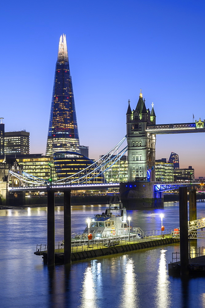 The Shard and Tower Bridge with Navel vessel on the River Thames, London