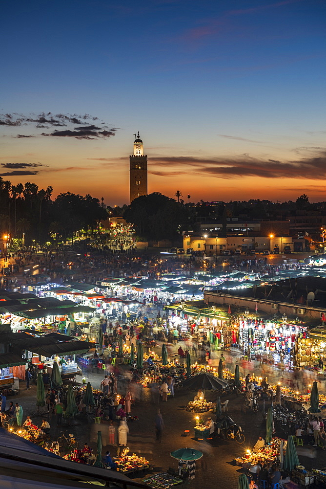 The view over the Djemaa el Fna at dusk showing food stalls and crowds of people, Marrakech, Morocco, North Africa, Africa