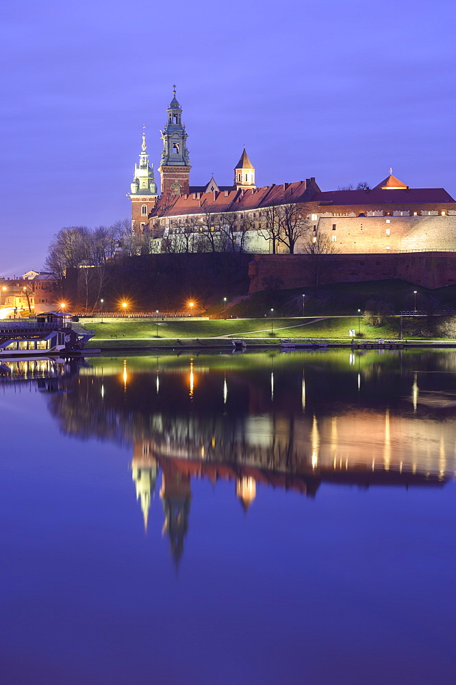 Wawel Castle reflected in the Vistula River, at sunrise, Krakow, Poland