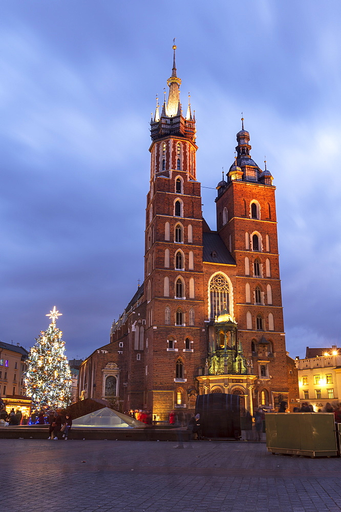 Saint Mary's Basilica at night with Christmas tree, Market Square, Krakow, Poland
