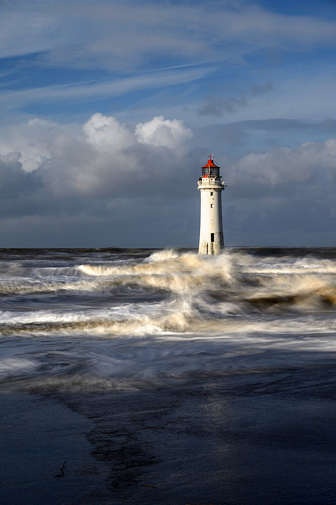 New Brighton lighthouse during stormy weather, The Wirral, Cheshire, UK