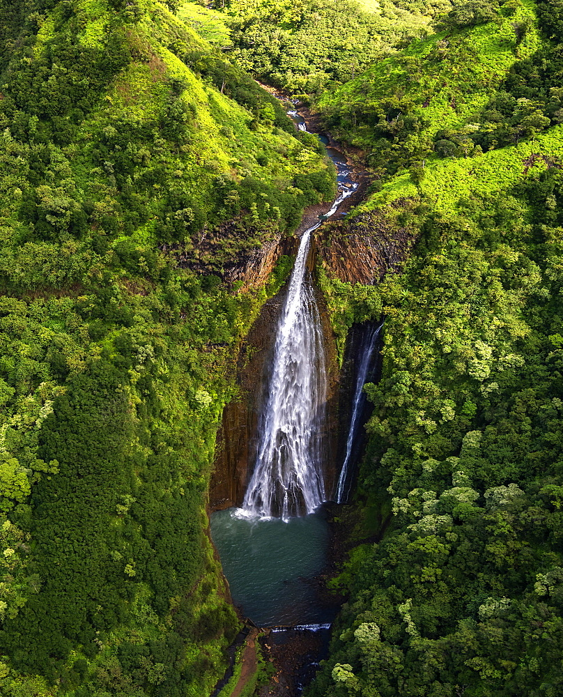 Aerial view of Manawaiopuna Falls, also known as Jurassic Park Falls, in the Hanapepe Valley on Kauai