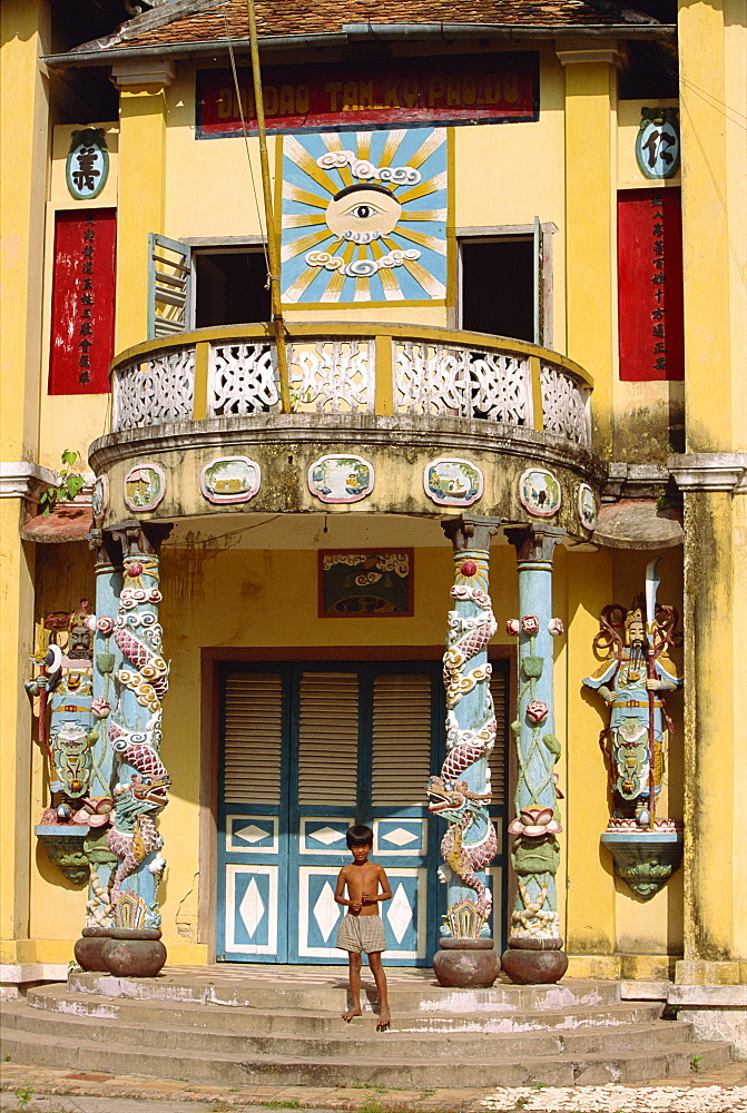 Small boy on steps of the rural Cao Dai temple in Tay Minh Province, Saigon, Vietnam, Indochina, Southeast Asia, Asia