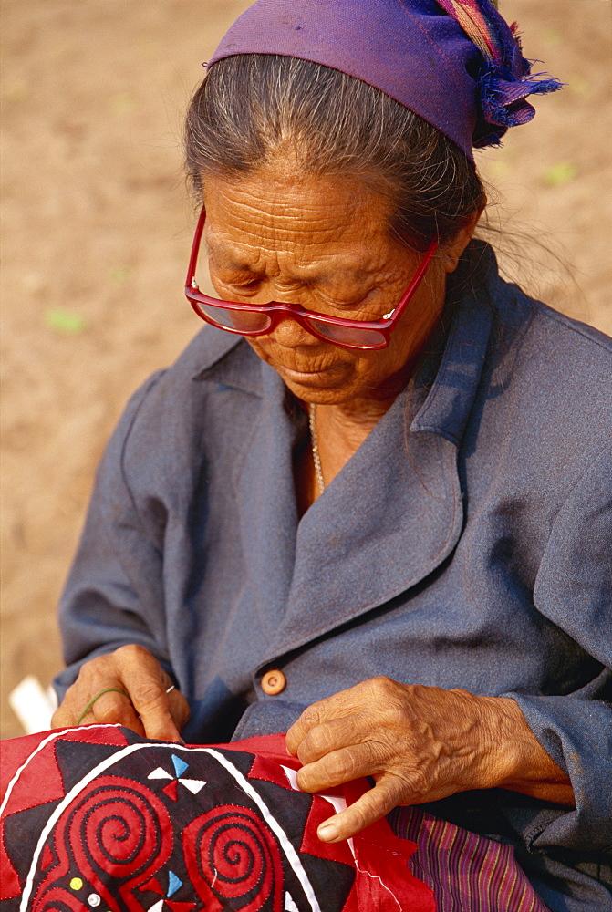 Hmong lady stitching at market, Luang Prabang, Laos, Indochina, Southeast Asia, Asia - 142-5103