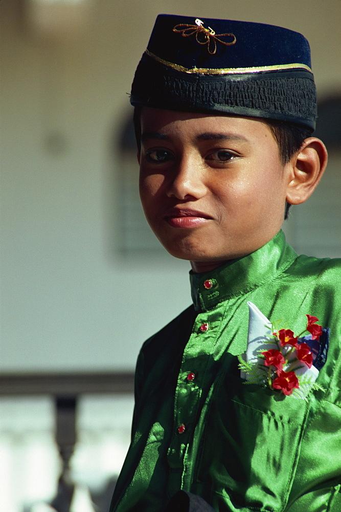 Boy in traditional costume, east coast, Malaysia, Southeast Asia, Asia - 142-5643