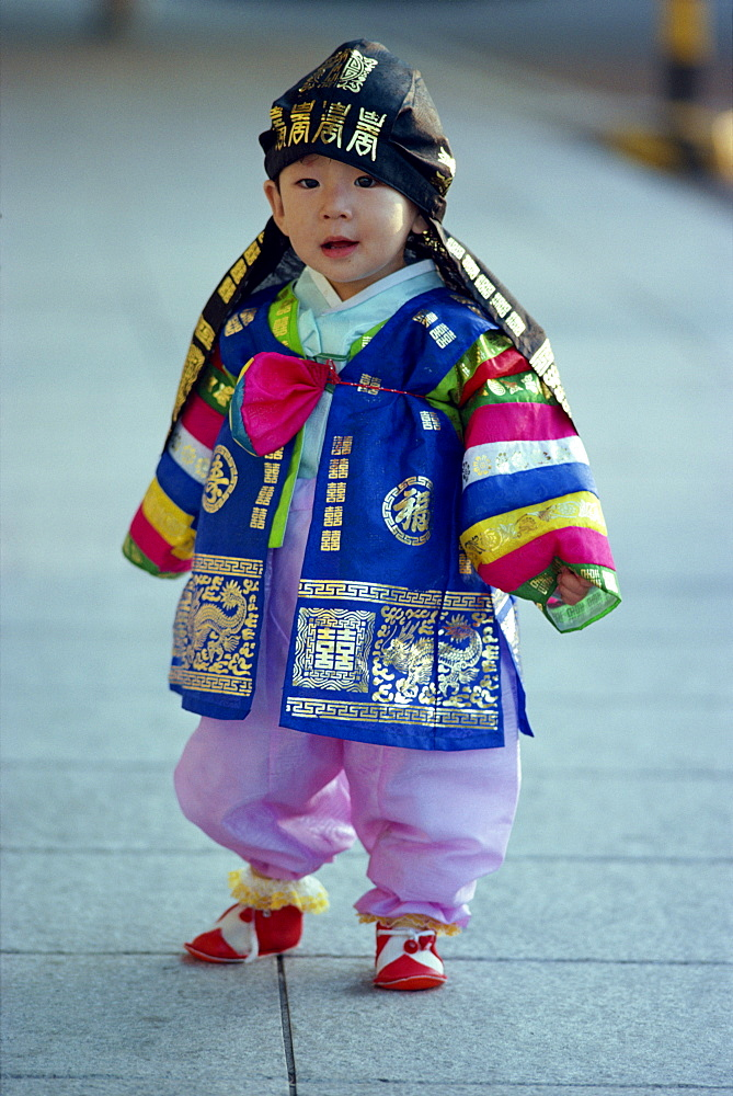 Portrait of a small boy in traditional costume on his first birthday, in Seoul, Korea, Asia