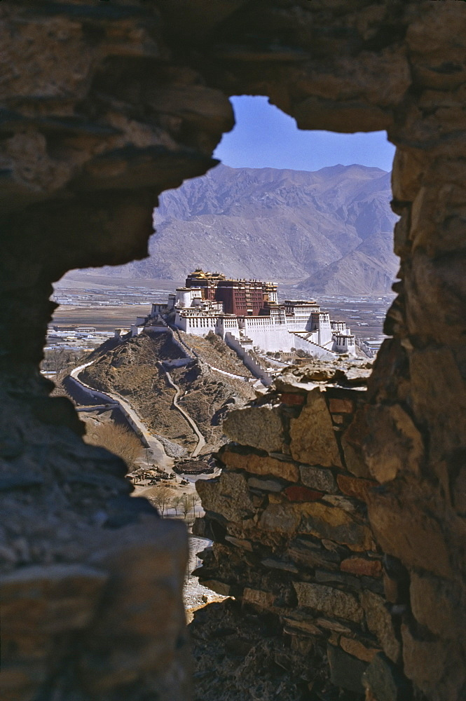 Potala Palace, UNESCO World Heritage Site, seen through ruined fort window, Lhasa, Tibet, China, Asia - 16-3223