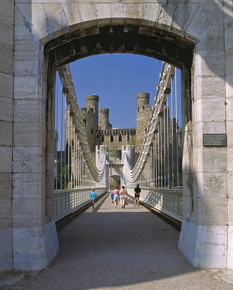 Telford Suspension Bridge, opened in 1826, leading to Conwy Castle, UNESCO World Heritage Site, beyond, North Wales, United Kingdom, Europe - 16-3238