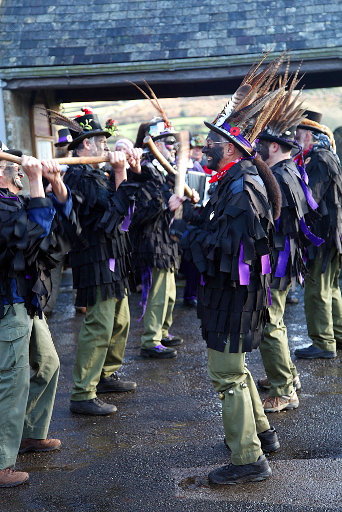 Morris dancers performing in front of the parish church in Widecombe, Dartmoor, Devon, England, United Kingdom, Europe