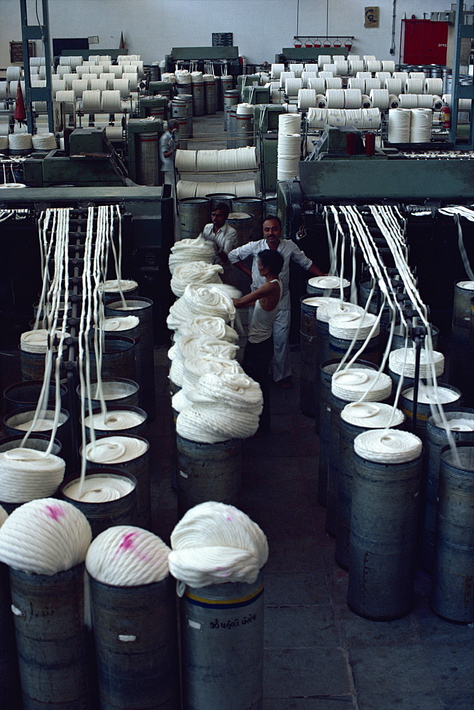 Interior of modernised cotton factory and workers, established over 100 years ago, Ahmedabad, Gujarat state, India, Asia