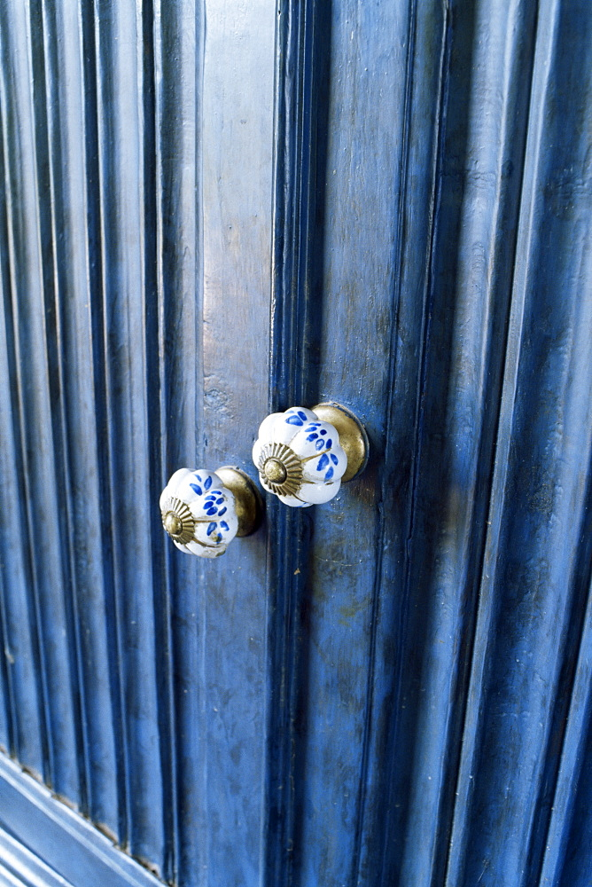 Detail of reproduction hand painted china cupboard door knobs in a home, near Ahmedabad, Gujarat state, India, Asia