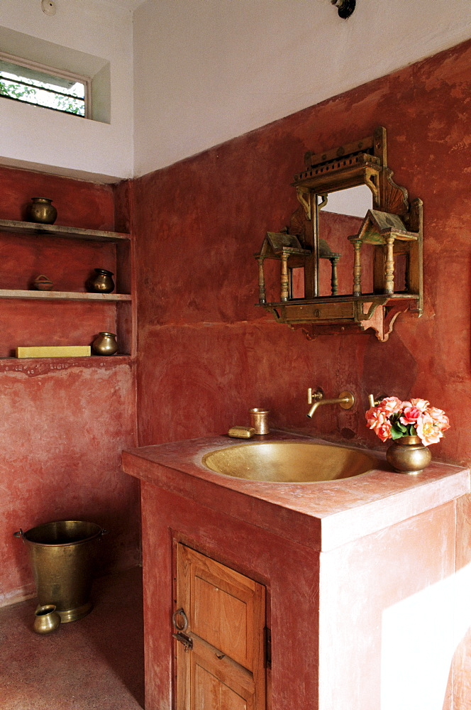 Pink finished plaster walls and hand beaten brass bathroom sink, residential home, Amber, near Jaipur, Rajasthan state, India, Asia