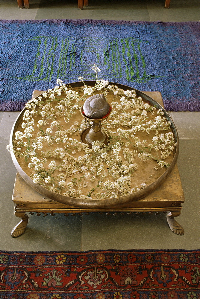 Flower arrangement in traditional brass thali, in a residence, Ahmedabad, Gujarat state, India, Asia