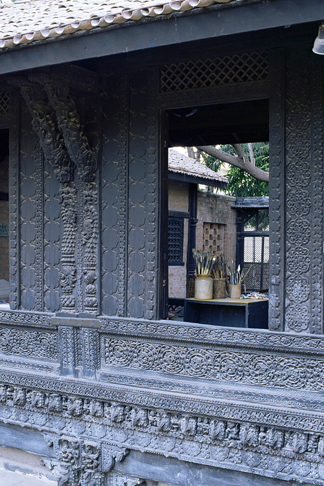 The exquisitely carved 300 year old wood facade of a Pol house, Ahmedabad, Gujarat state, India, Asia