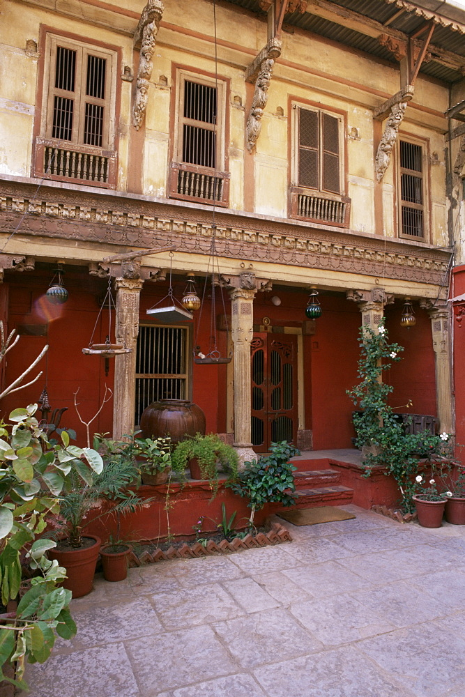 Restored traditional Pol house, an all wood structure, with wood carved facade, some 300 to 400 years old, Ahmedabad, Gujarat state, India, Asia