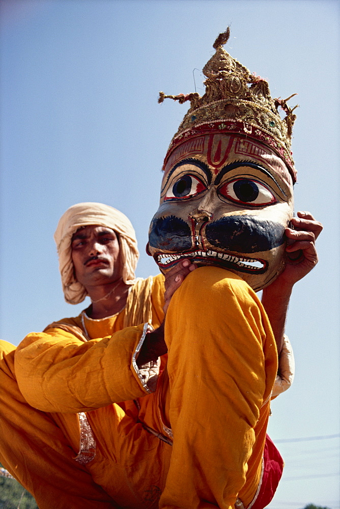 Actor with mask worn in the Ramlilla, the stage play of the Hindu epic the Ramayana, Varanasi, Uttar Pradesh state, India, Asia