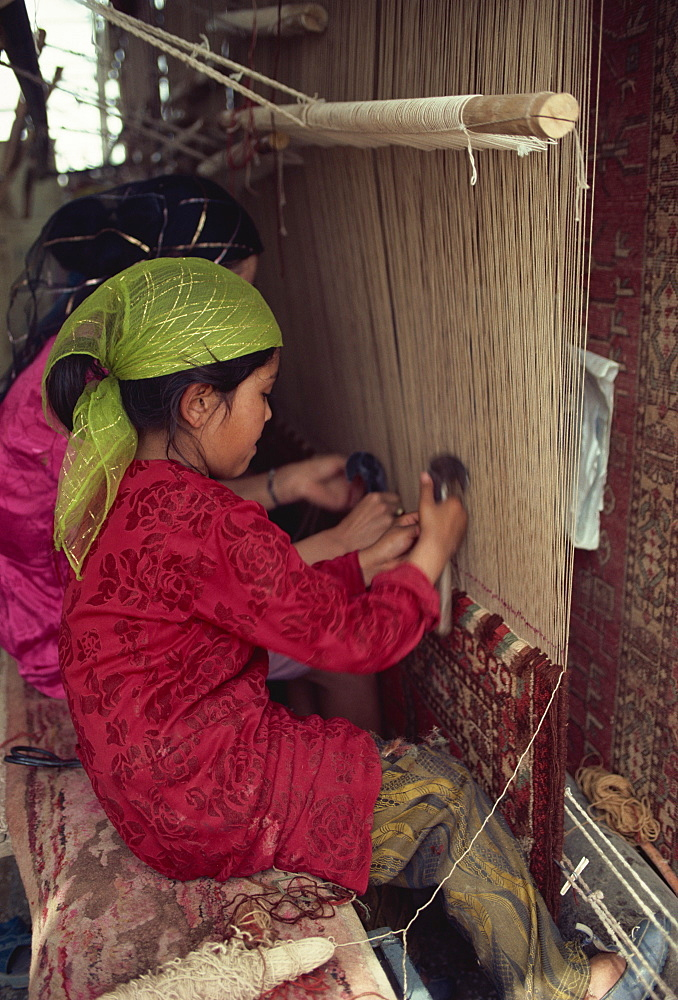 Uyghur children learning to make carpets, Hotan, China, Asia