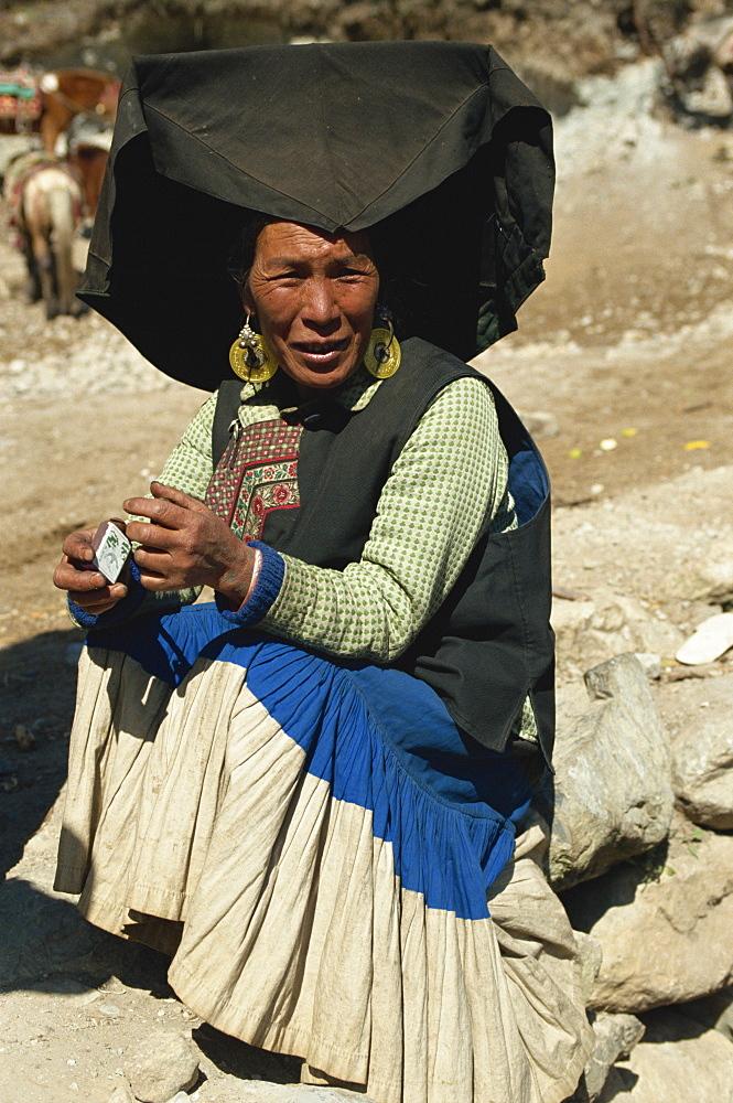 Yi person near Lijiang, Yunnan, China, Asia - 188-5419