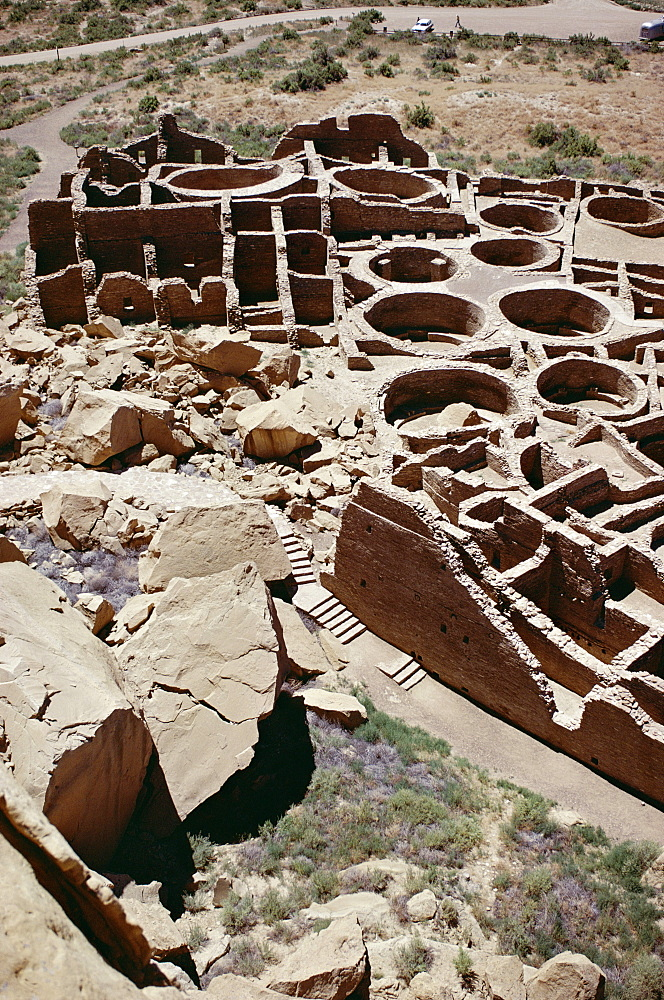 Kivas and rooms, foreground rock fall destroyed part of pueblo, Pueblo Bonito 1000-1100 AD, Anasazi site, Chaco Canyon National Monument, New Mexico, United States of America (U.S.A.), North America