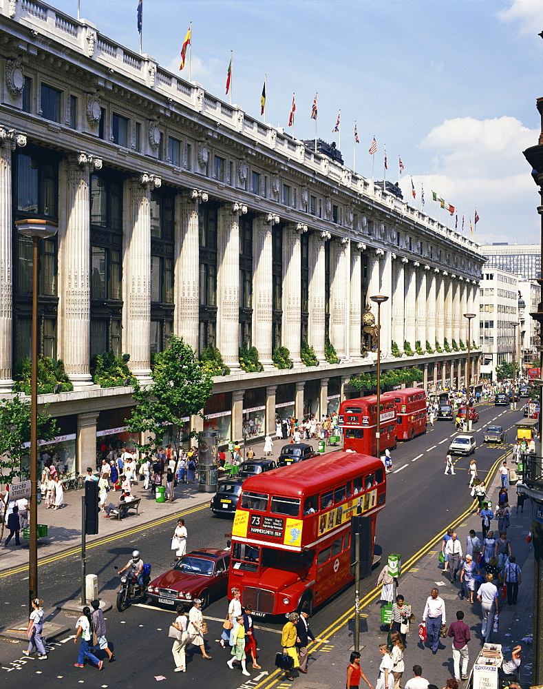 Selfridges department store and old Routemaster bus before they were withdrawn, on Oxford Street, London, England, United Kingdom, Europe