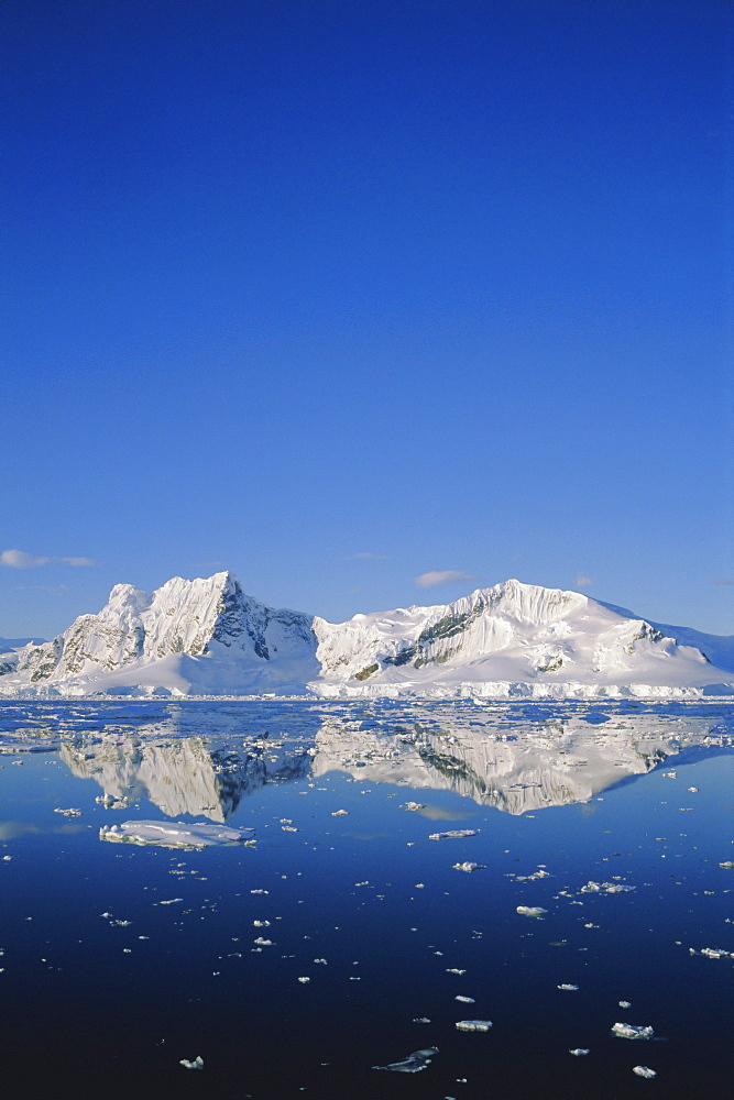 Landscape reflected in water, Antarctic Peninsula, Antarctica