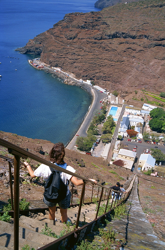 Tourists walking down flight of steps called Jacobs Ladder, towards the harbour at Jamestown, St. Helena, Atlantic Ocean, Mid Atlantic