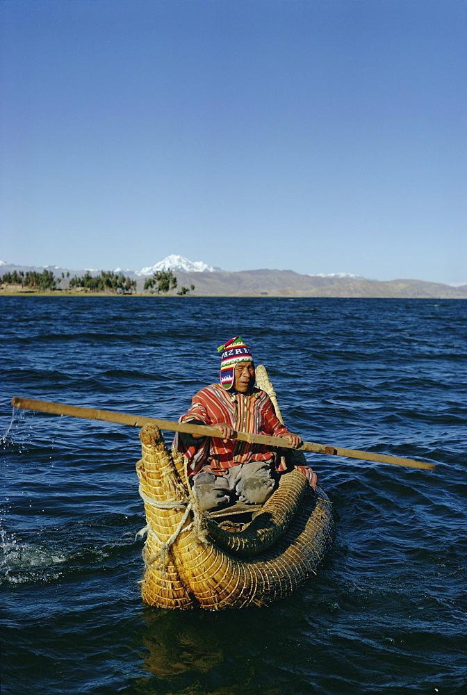 Aymara Indian in a reed boat, Lake Titicaca, Bolivia, South America