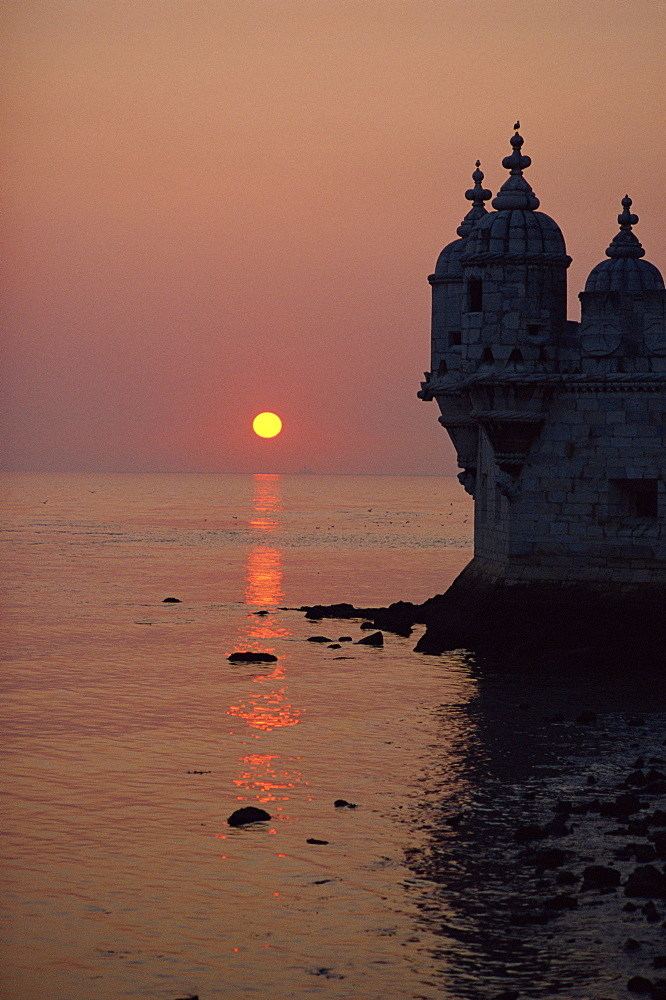 Turrets of the 16th century Belem Tower silhouetted in the sunset, in Lisbon, Portugal, Europe