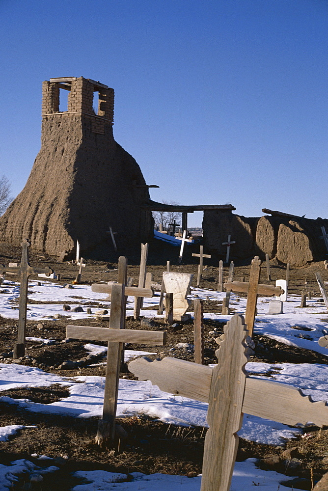 Snow on the ground in February in the old churchyard which was destroyed in the 1847 revolt when 150 Indians died, Taos Pueblo, UNESCO World Heritage Site, Taos, New Mexico, United States of America (U.S.A.), North America