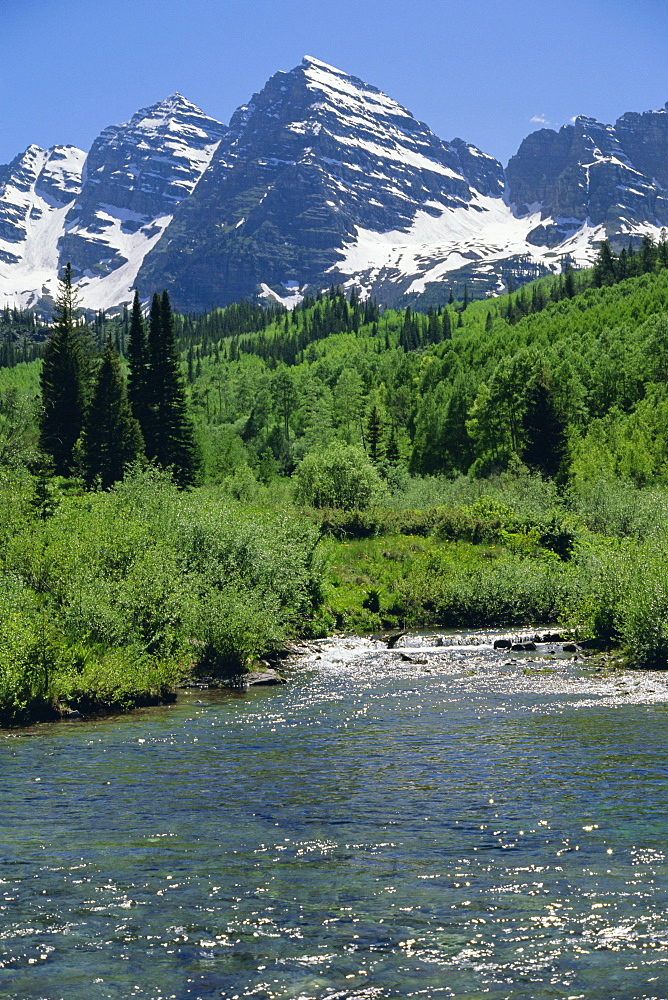 Maroon Bells seen from stream rushing to feed Maroon Lake nearby, Aspen, Colorado, Rocky Mountains, USA, North America