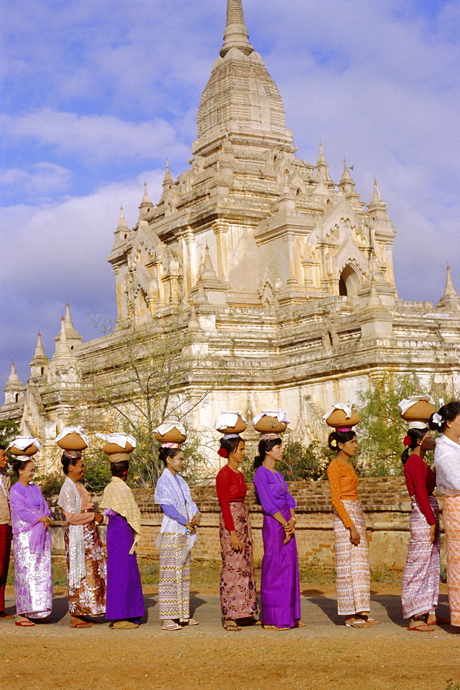 A line of women at a ceremony for the ordination of Buddhist monks, Bagan (Pagan), Myanmar (Burma), Asia