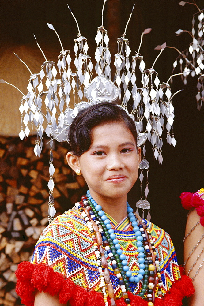 Head and shoulders portrait of an Iban girl, Sarawak, island of Borneo, Malaysia, Southeast Asia, Asia